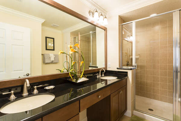 The master bathroom his and hers vanities and a walk in shower.