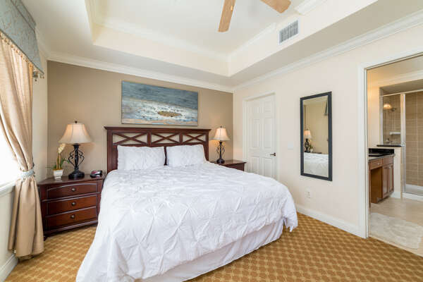 There is a king sized bed in the master bedroom