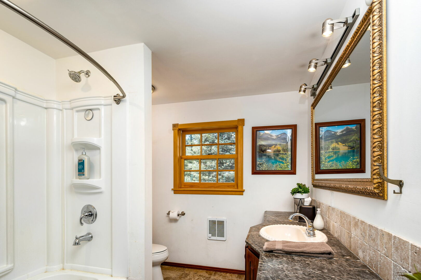 Full bathroom located on main level shared between main level bedrooms.