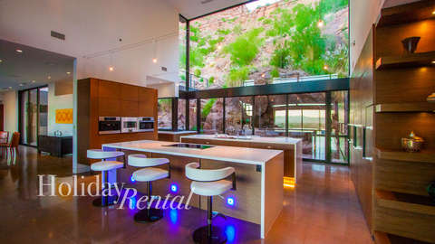Kitchen view and water fall features right behind the kitchen