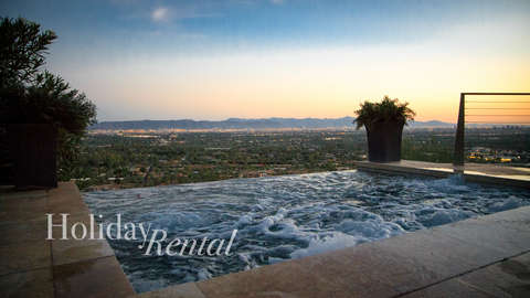 Separate hot tub on the lower level with the same city views as the pool!