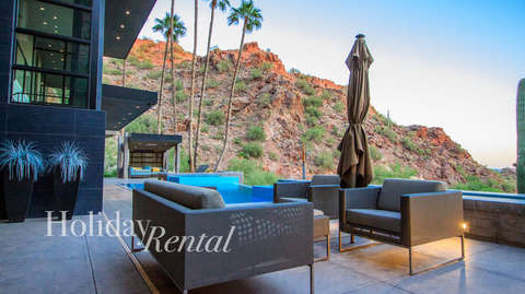 Front seating area near pool with mountain view