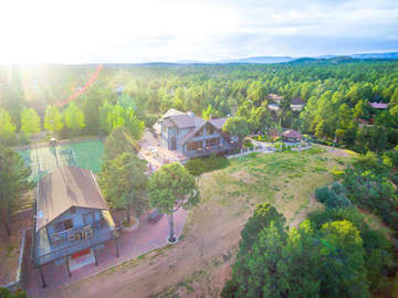 Arial view of entire property, including guest house, and main house. NOTE TENNIS COURT NOT ADVERTISED FOR GUEST USE
