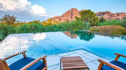 Pool side view with a great view of the Camelback Mountain in the back
