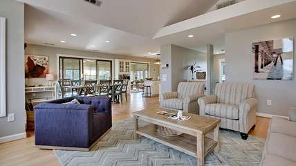 Other highlights in the great room include hardwood flooring and deck access.