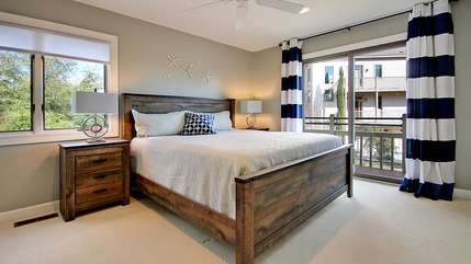 The 2nd bedroom has a king bed and deck access.