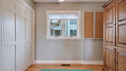 Off the family room is a nook with a full murphy bed.