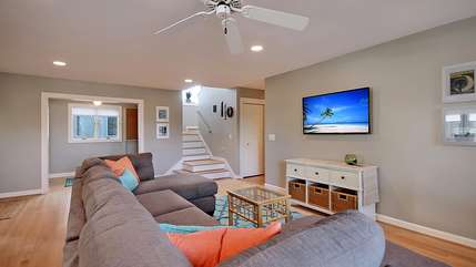 This home has a reverse floor plan. Enter into the large family room.