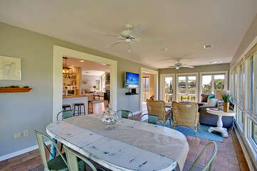 Another table in the sunroom affords additional eating seating as well as a table for board games.