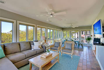 Watch your favorite movies or shows on the large HDTV in the newly remodeled sunroom with all new furniture.
