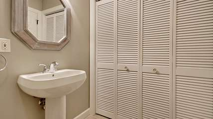 Off the living room is a powder room with a full laundry.