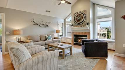 The newly redecorated great room has high ceilings and a gas fireplace.