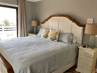 The master bedroom is on the upper level and has a king bed.