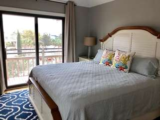 The Master bedroom has a slider leading to a private deck area.