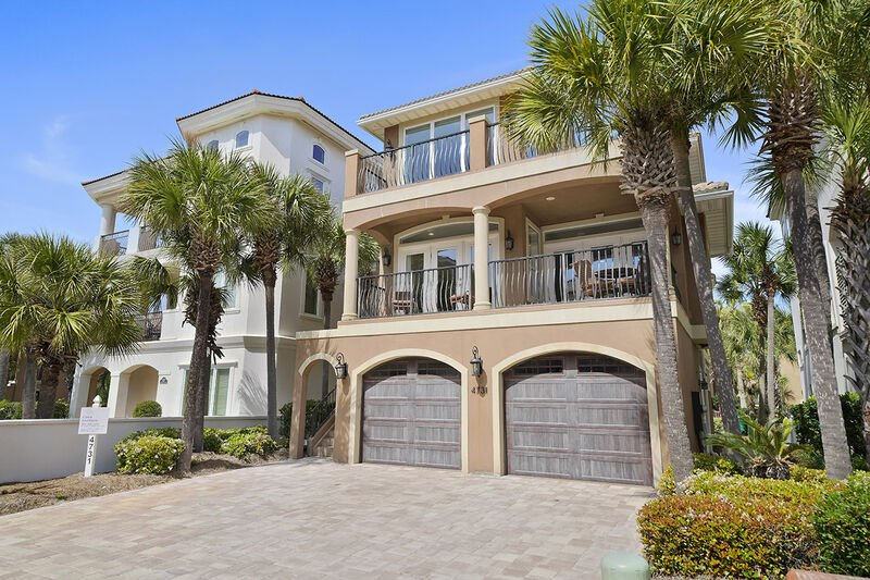 The front and twin garages of this Destiny By The Sea House Rental