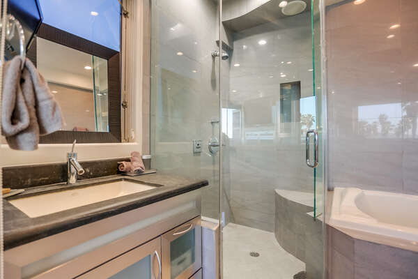 Master en suite bathroom with shower and large tub