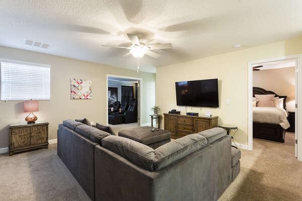 Second floor den with an additional flatscreen TV