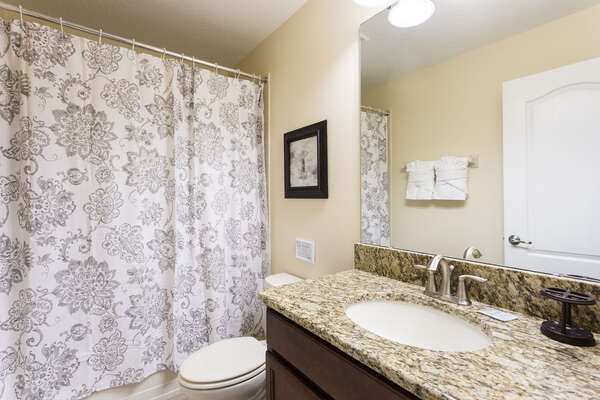 Upstairs bathroom with a combination tub and shower
