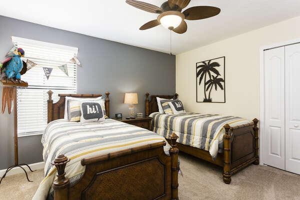 The twin bedroom has a fun beach theme