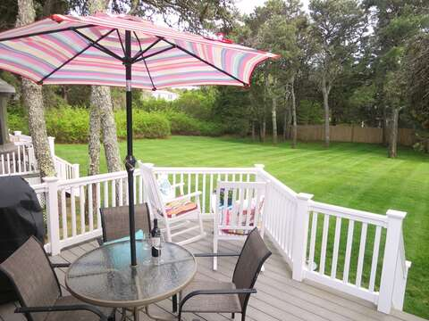 Table , chairs and gas grill on the deck!