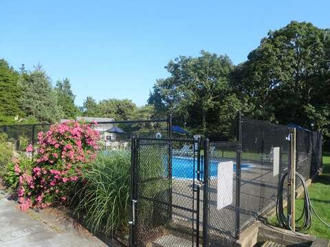 entry to pool- fully fenced in - 767 Route 28 #5 Harwich Port Cape Cod New England Vacation Rentals