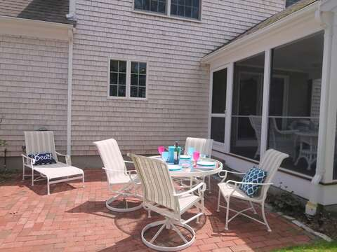 Patio for outdoor dining and screened in porch - 30 Cockle Cove Road Chatham Cape Cod New England Vacation Rentals