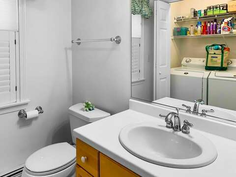 Half bath on 1st floor is located off of the hallway and has a washer and dryer - 30 Cockle Cove Road Chatham Cape Cod New England Vacation Rentals