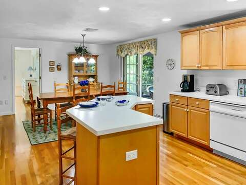 Open concept kitchen with island at- 30 Cockle Cove Road Chatham Cape Cod New England Vacation Rentals
