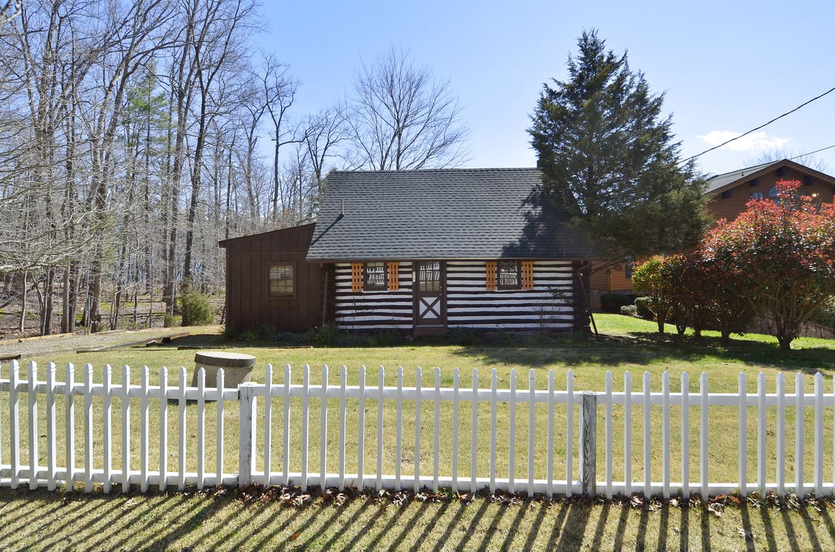 Image of Fenced-In Log Cabin.