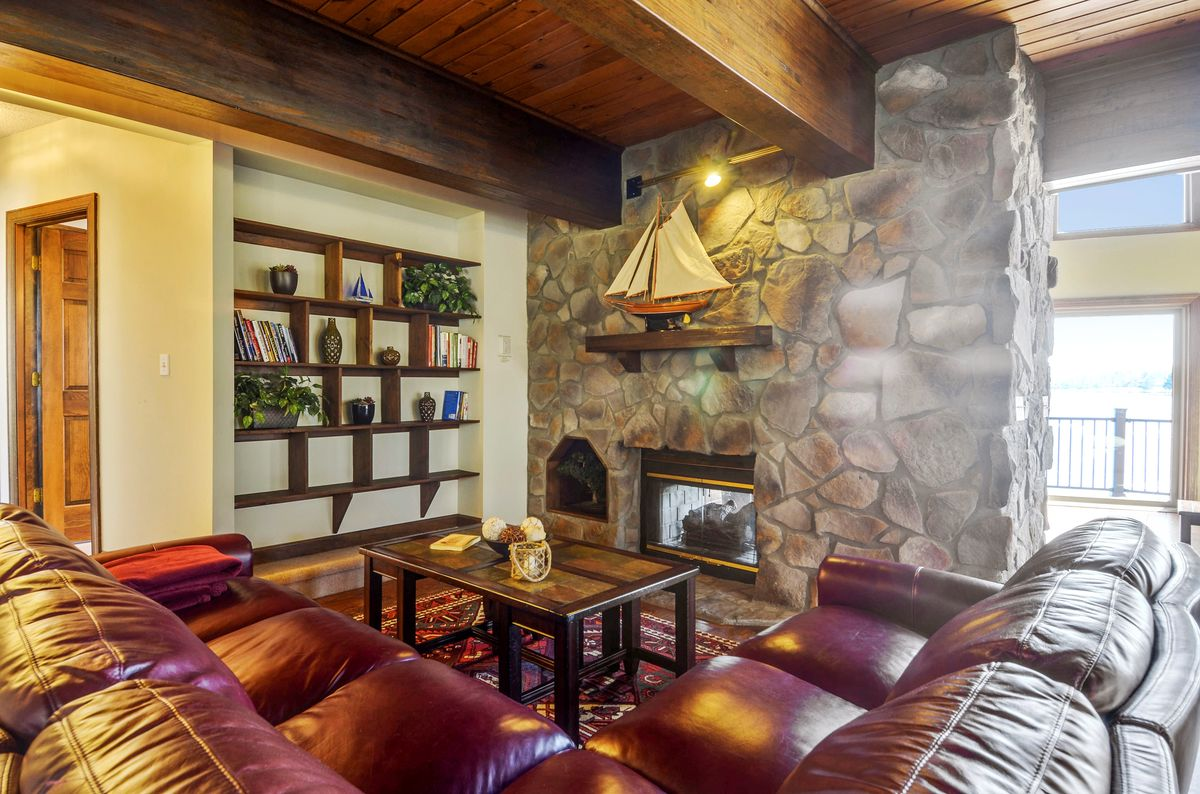 Living Room Includes Fireplace and Views of the Lake