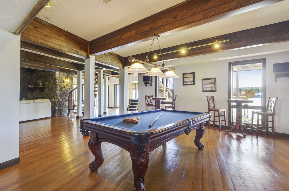 Game Room Includes Pool Table.
