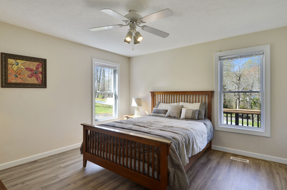 Main Level Bedroom with Queen Bed and Ceiling Fan