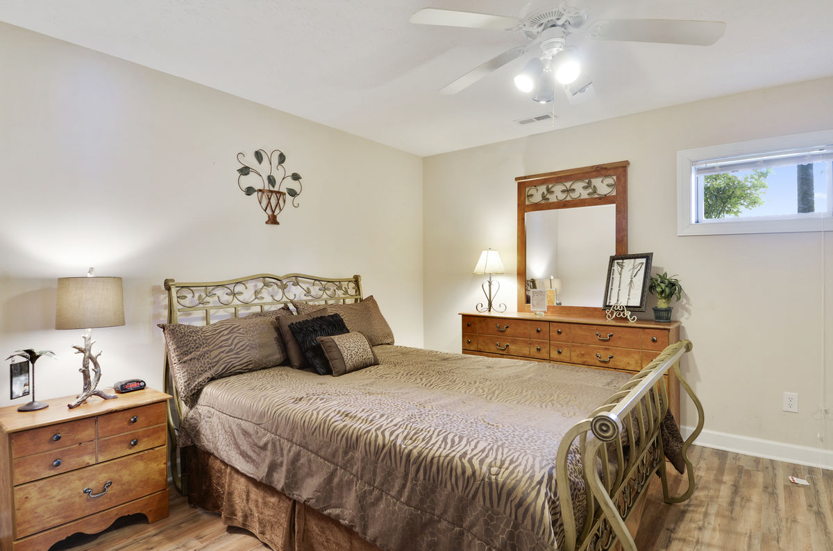 Lower Level Bedroom with Queen Bed, Dresser, and Chest of Drawers