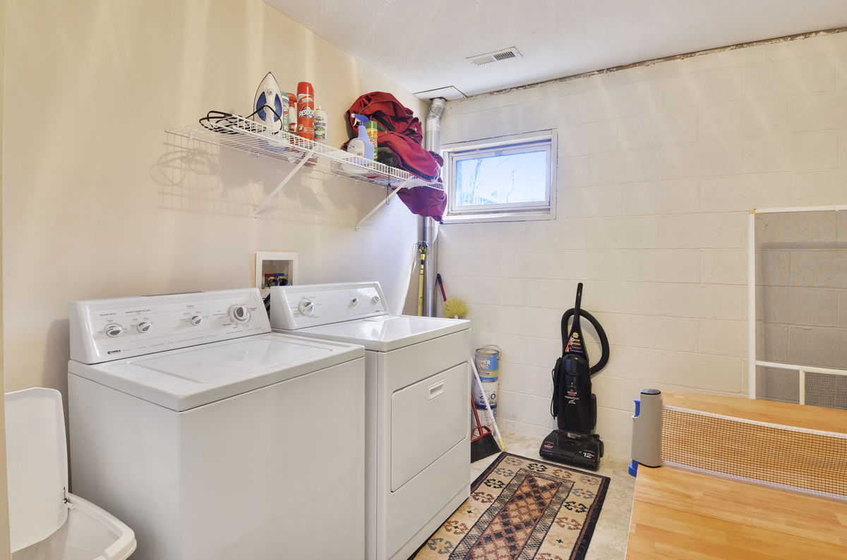 Laundry Room with Washer and Dryer and Ping Pong Table