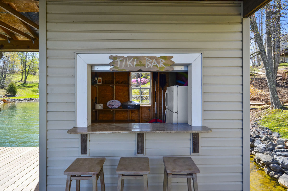 Tiki Bar with seating for three. no refrigerator at the dock .