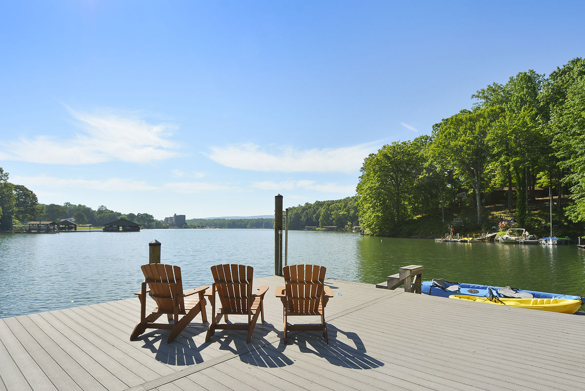 Three Chairs on a Dock with Kayaks