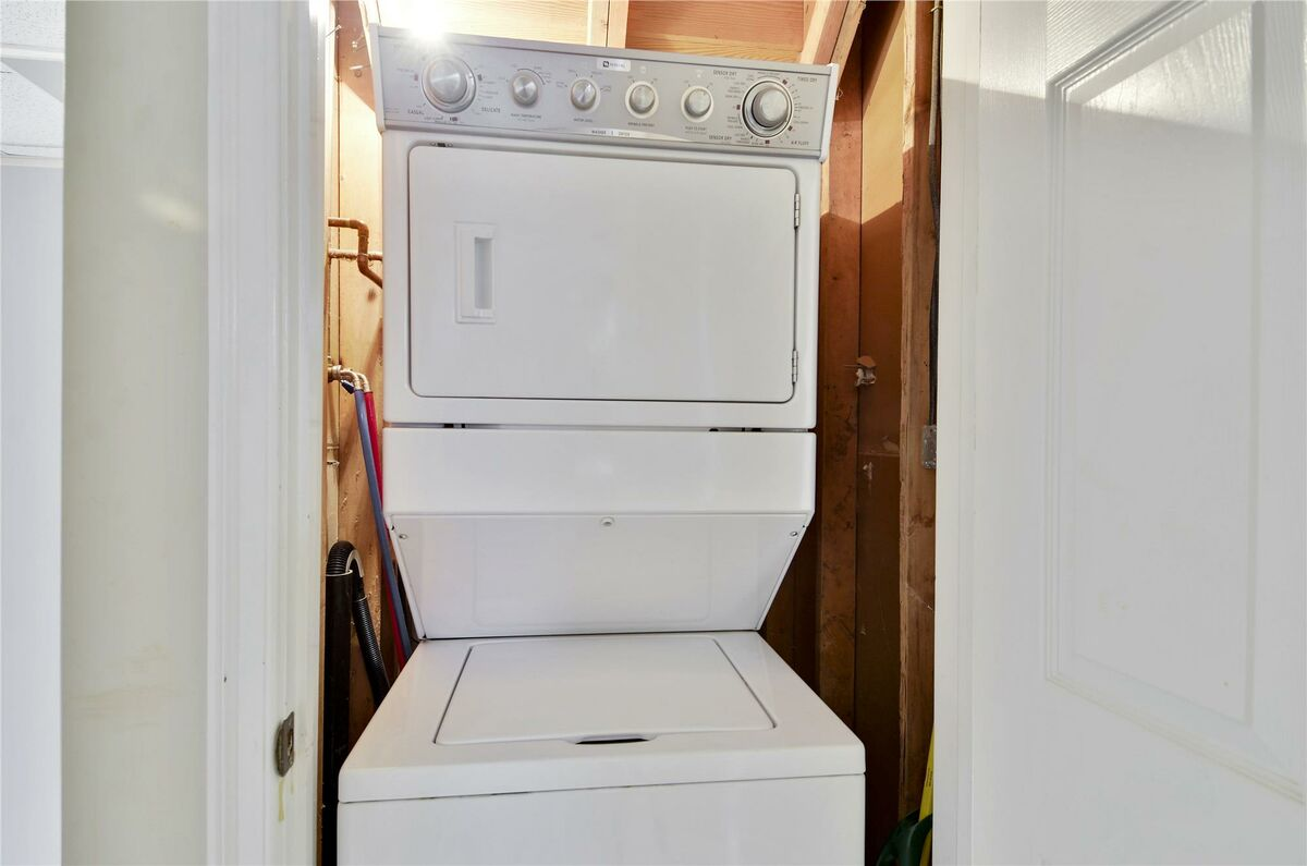 Laundry Area with Stacking Washer/Dryer