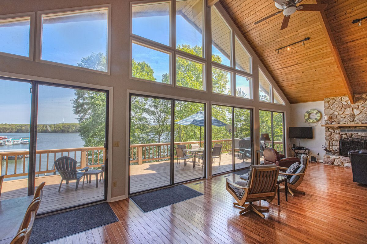 Living Area with Floor-to-Ceiling Windows and view of Lake