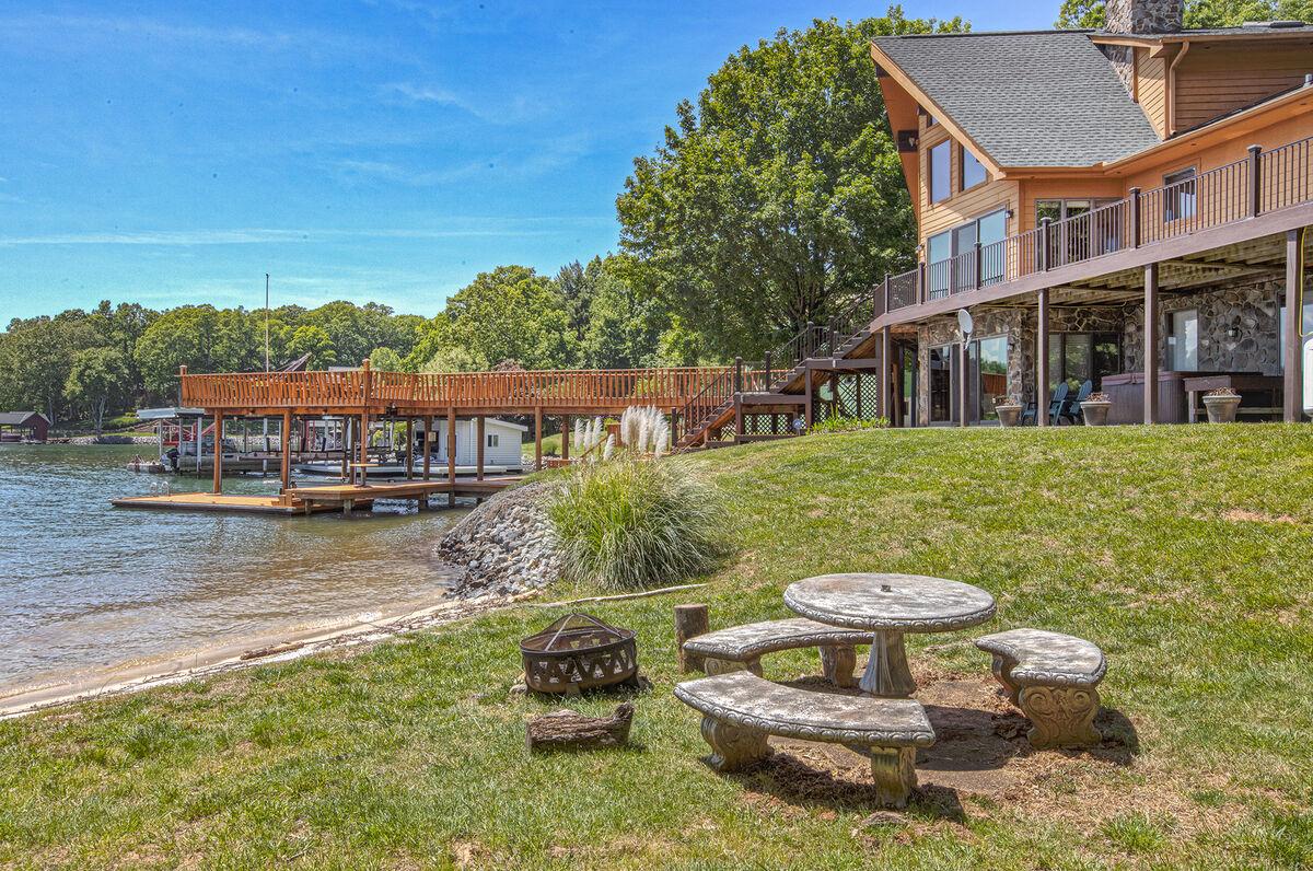 Enjoy Backyard Seating Near Lake.