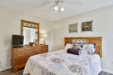 Main Level Bedroom with Queen Bed, Dresser, and TV