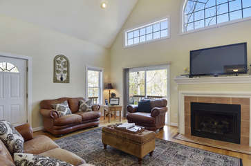 Great Room with Leather Couches, TV, and Fireplace
