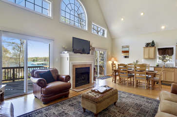 Great Room and Dining Area with Fireplace and Views to the Lake