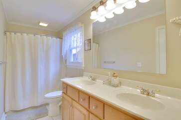 Full Bathroom with Double Vanity and Shower/Tub Combo