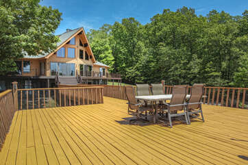 Spacious Wooden Deck Features Outdoor Dining.