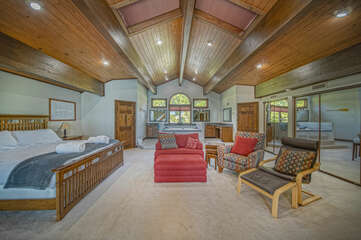 Large Bedroom Includes Bed and Three Chairs.