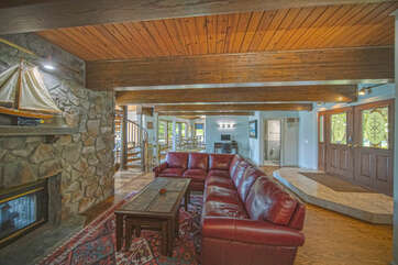 Image of Sectional, Coffee Table, and Fireplace.
