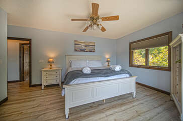 Master Bedroom Features Natural Light From Windows.