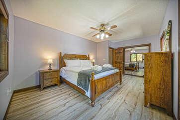Spacious Bedroom Includes Wood Furnishings.