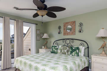 The upstairs 2nd bedroom has a king bed and doors leading to a deck.