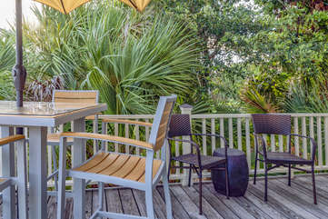 Step through the sliders and relax on your beautiful deck.